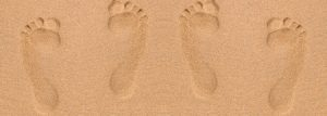 44193910 - footprints in sand at the beach