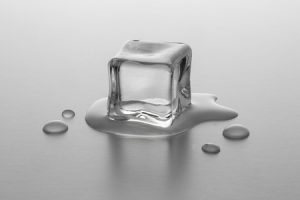 38587126 - melting ice cube on gradient background